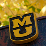 MU sign with fall leaves in background