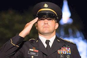 Master Sgt. Justin A. Hardy soluting