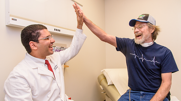 doctor and patient give each other a high five