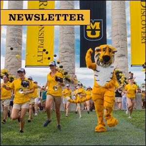 Newsletter - Freshman running through the Columns during Tiger Walk