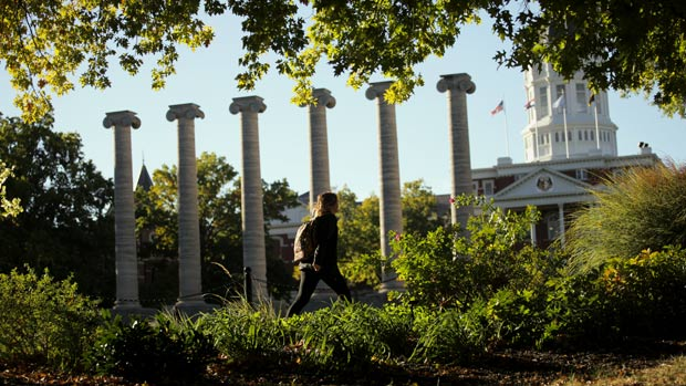 Student walks in front of the columns