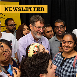 Newsletter: Picture of Nobel Laureate George P. Smith surrounded by members of Mizzou community