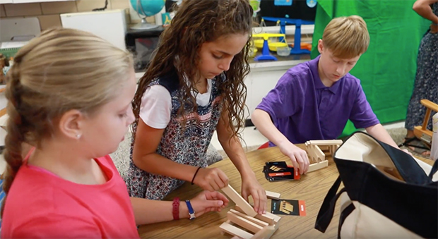 Elementary students working with blocks