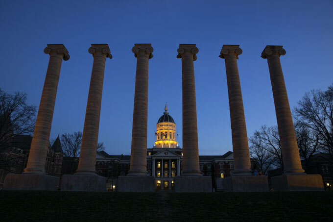 Jesse Hall and the columns at night