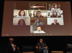This is a photo of Professors Stacey Woelfel and Bill Horner and their student contributors to the documentary during the talk-back session.