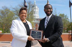 A photo of Chalana M. Scales-Ferguson, Esq. receiving an award from Vice Chancellor Maurice Gipson