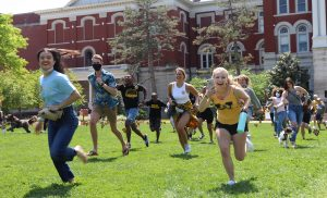 A photo of Ashley Rolf and other students running for Tiger Prowl
