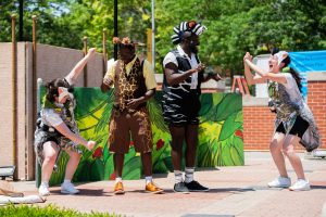 A photo of Rachel Misner, Reggie Coleman, Preston Wilson and Nathan Le as characters in Madagascar