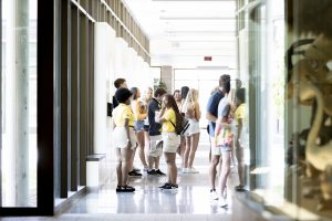 A photo of Summer Welcome student leaders and new students gathering outside Conservation Hall.